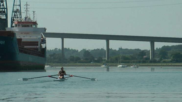 Sculling past the docks at Ipswich Rowing Club